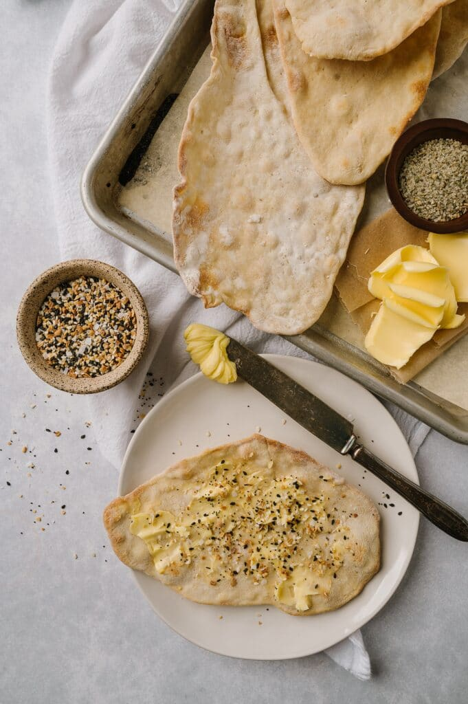 baked matzo dough with butter and seasoning on it