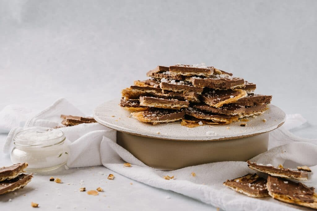 salted toffee matzah on a cake stand