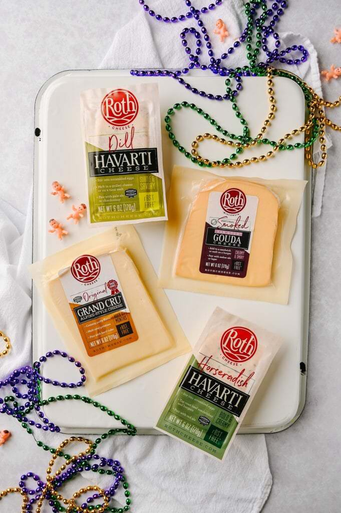roth cheeses on a platter surrounded by mardi gras beads