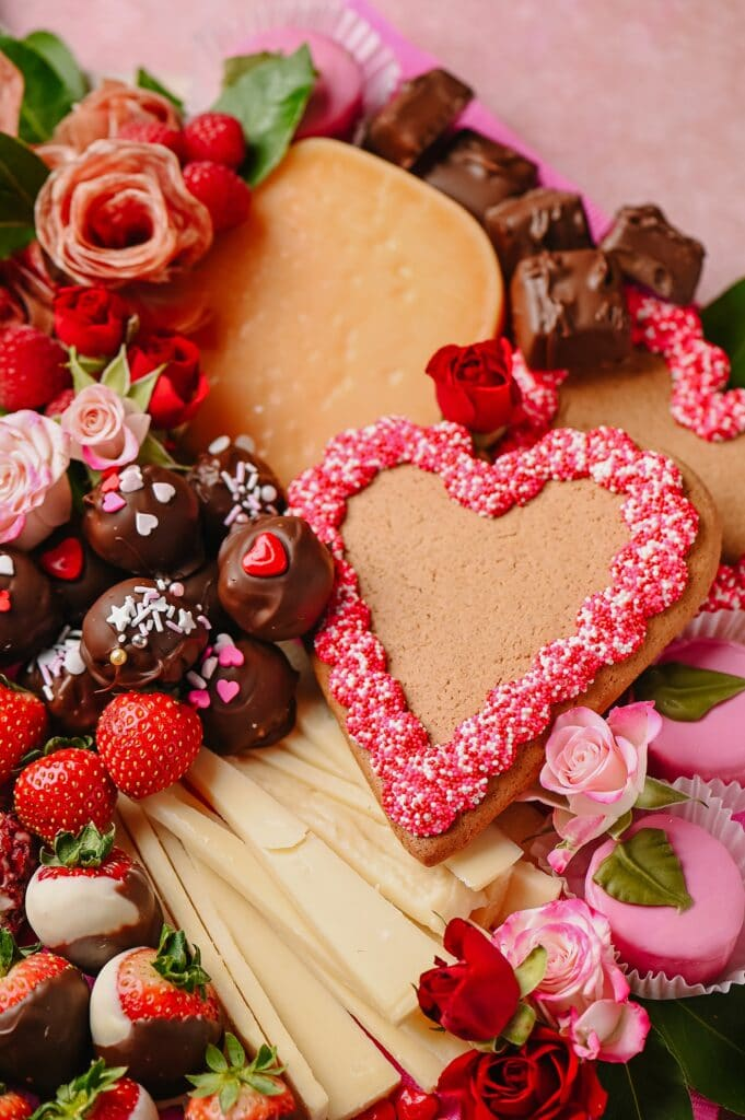 large gingerbread heart on a Valentine's day inspired cheeseboard