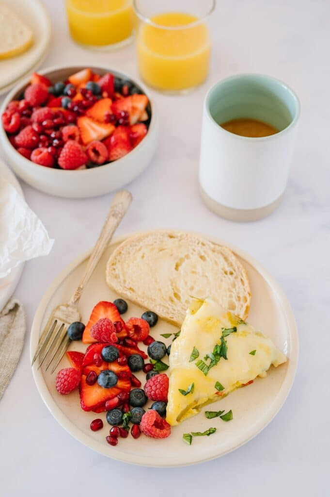 frittata, berries, and toast on a plate