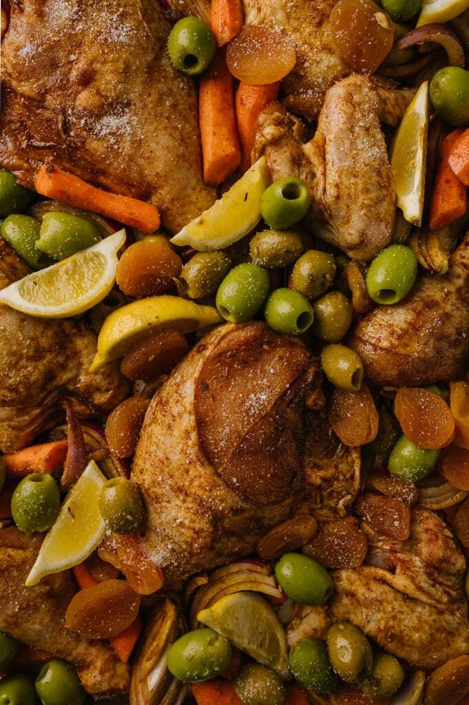 close up of morrocan sheet pan chicken and vegetables on a sheet pan