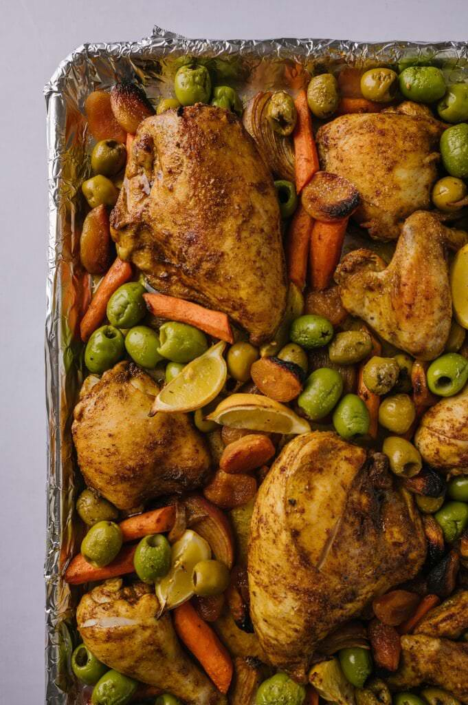 fully baked Sheet Pan Moroccan Chicken with Olives and Apricots on a pan