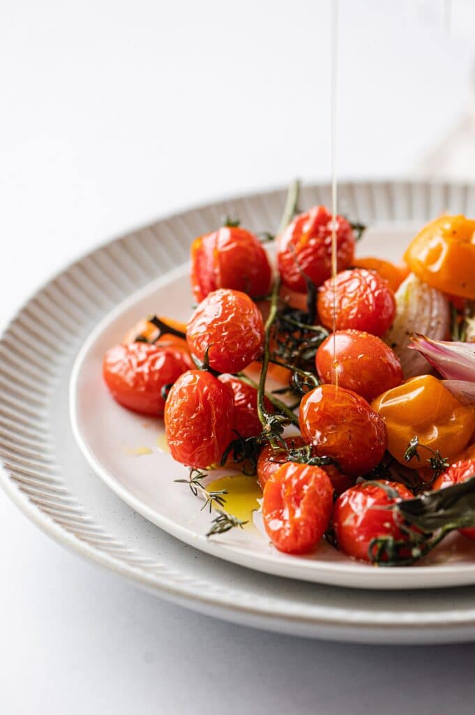 roasted tomatoes with a stream of olive oil
