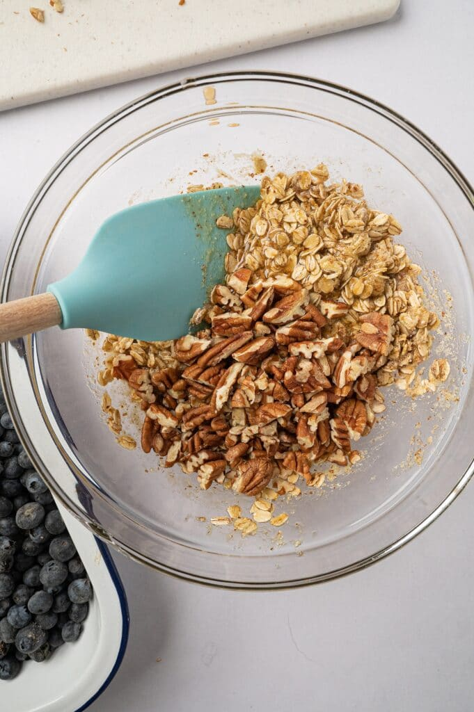 mixing ingredients for gluten free blueberry crisp