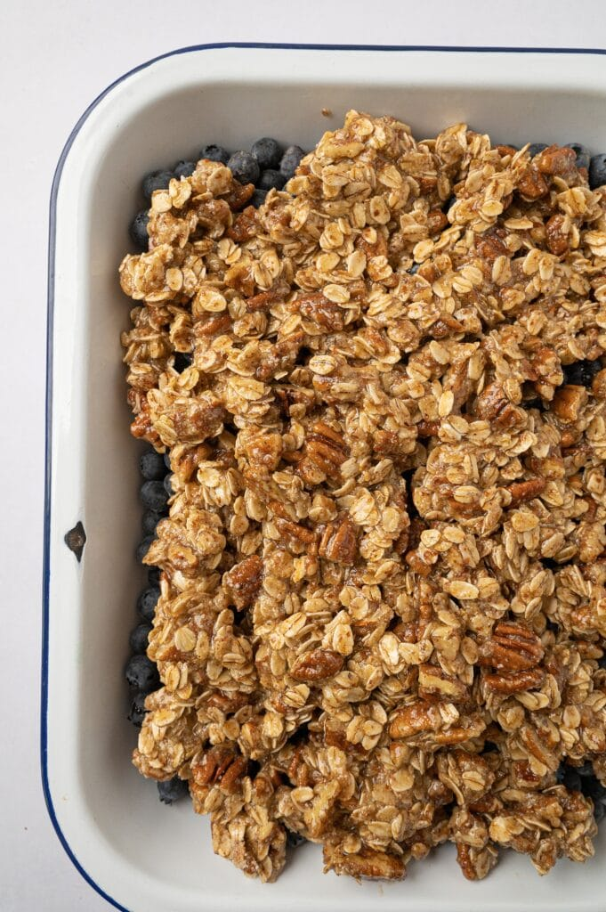 close up of gluten free blueberry crisp in a dish