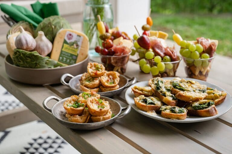 three spinach and artichoke appetizers on a table