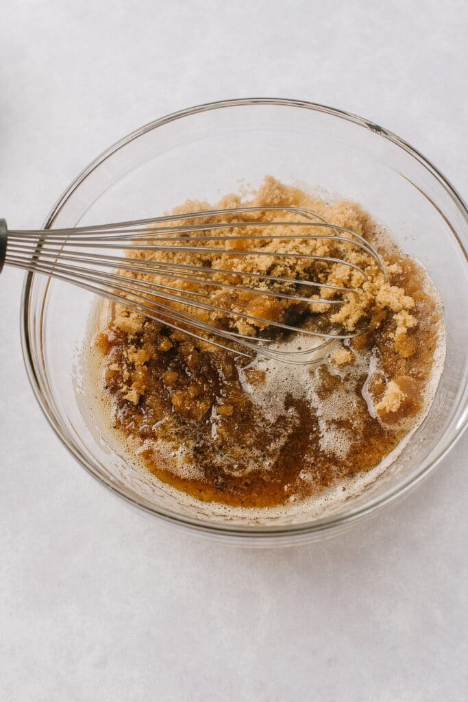 mixing brown sugar and butter in a bowl