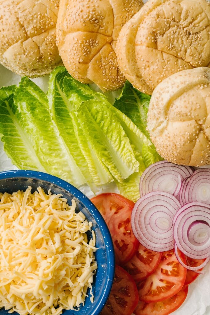 toppings for chicken burgers on a platter