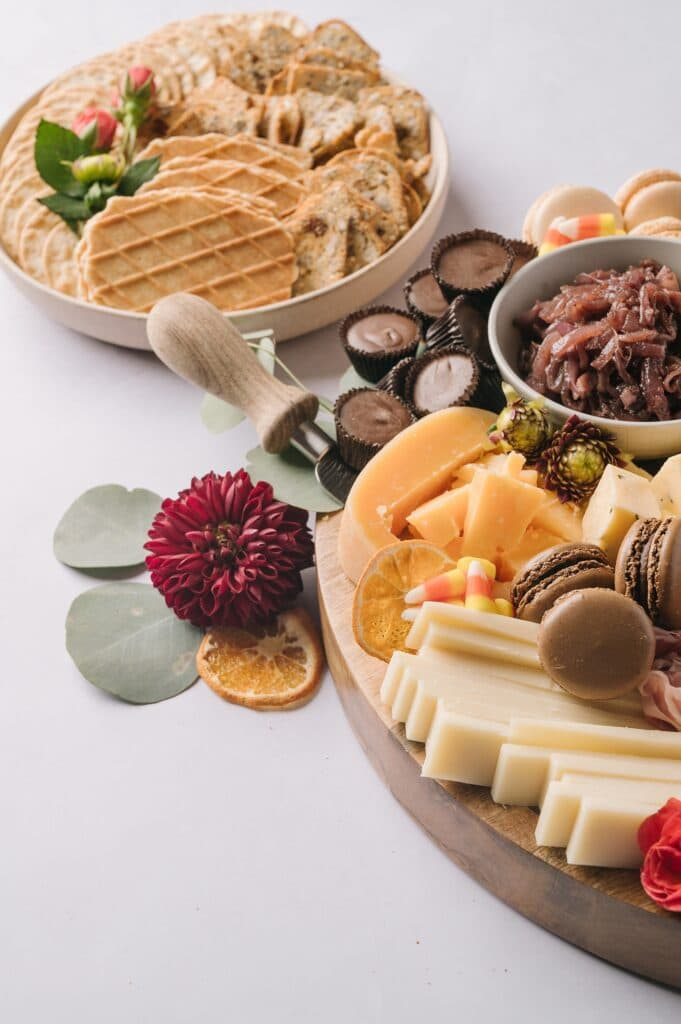 fall decorations around a cheeseboard